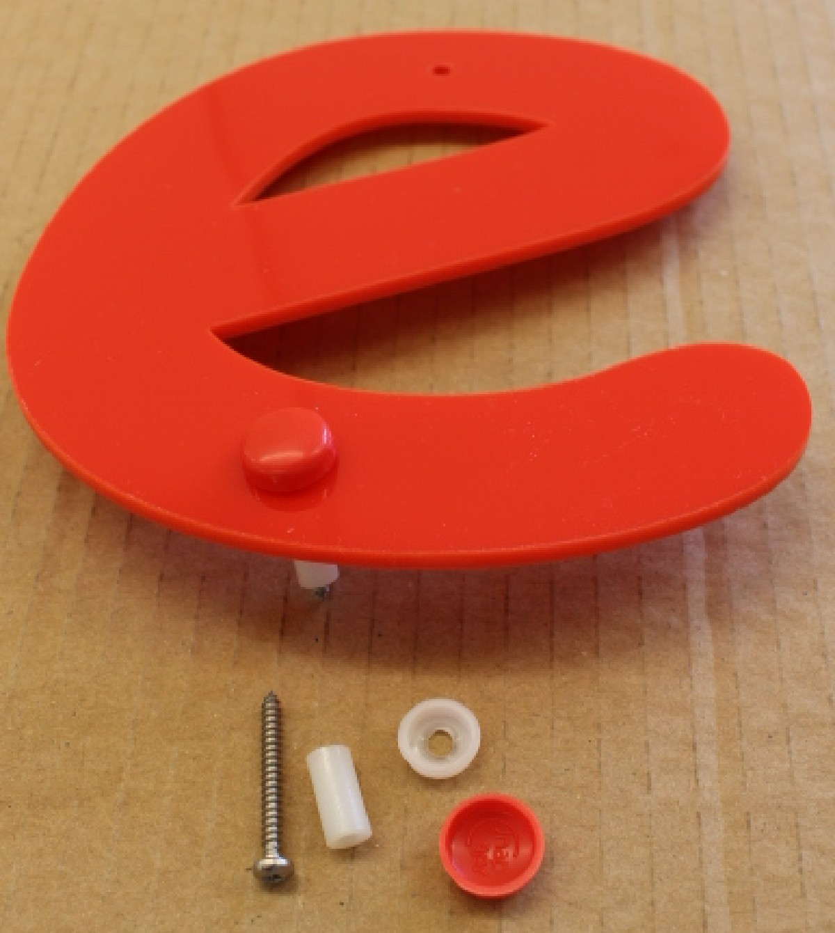 letters with screws, fittings and caps